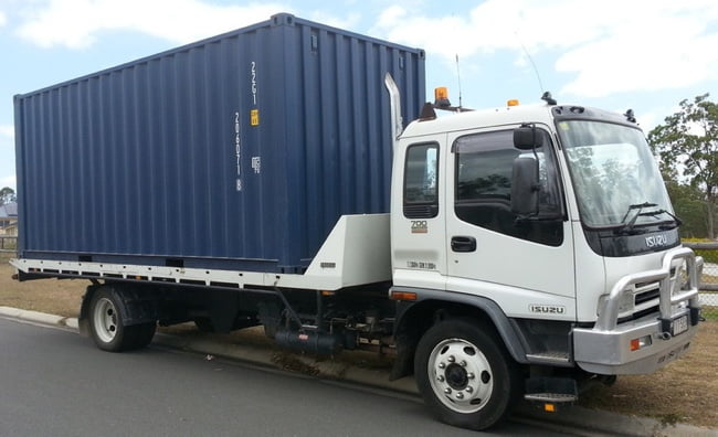 Shipping container being delivered in Melbourne